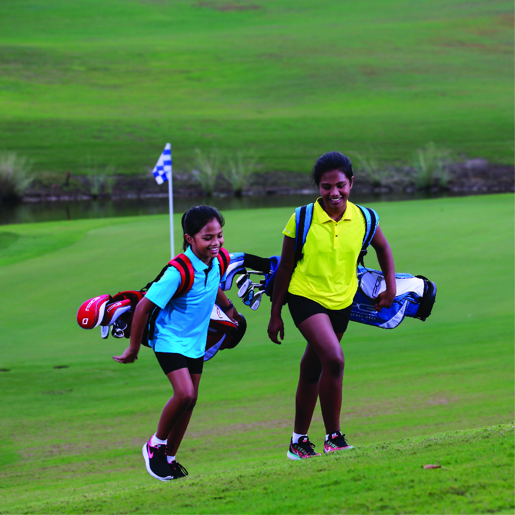 Two kids enjoy a junior golf lessons at The Els Club Malaysia